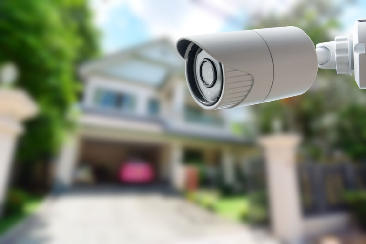 Security Camera With Unfocussed House in Background