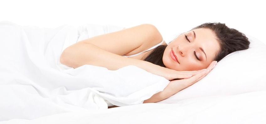 Woman Calmly Sleeping on Beb